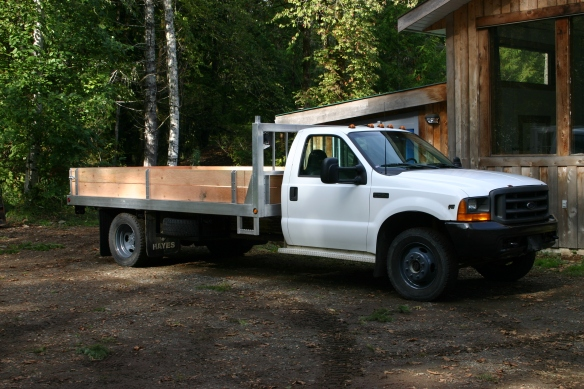 14' Aluminum and fir deck with stake sides.